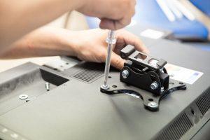 Handyman attaching a TV bracket