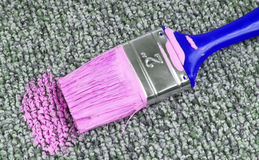 Removing spilt paint from textile floor covering