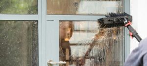 Cleaning windows with pure water by a professional window cleaner