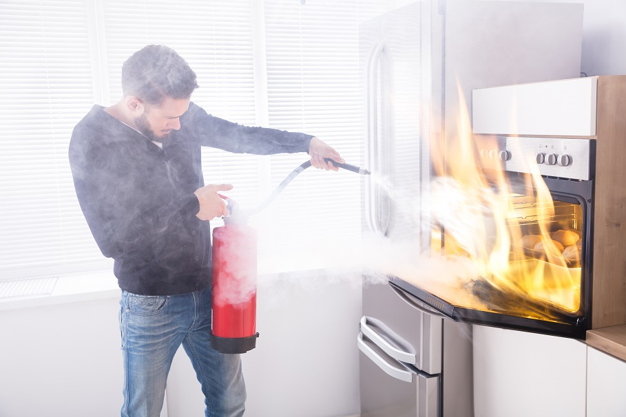 how to put out an oven fire