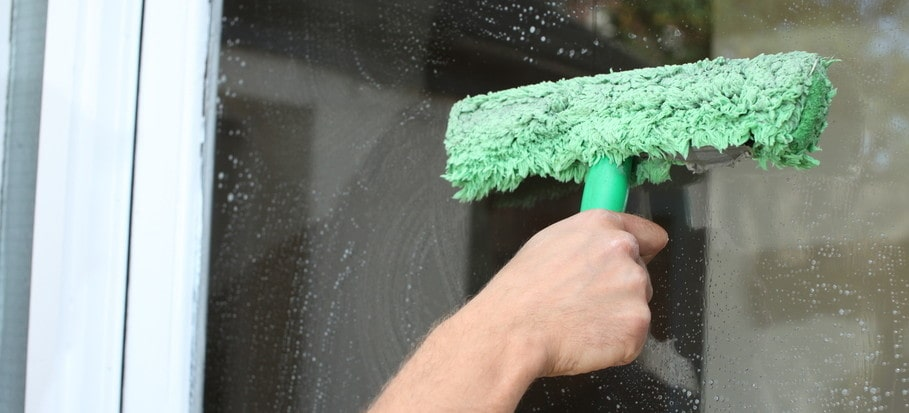 washing outside window with mop