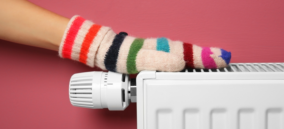 Central heating - hand in mitten on radiator