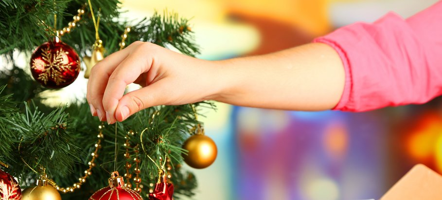 putting up and decorating a Christmas trees