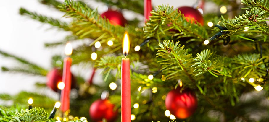 Open flame candles on a Christmas tree