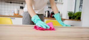 woman cleaning a kitchen