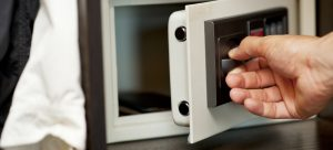 A person opening an electronic safe