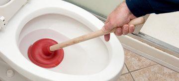 unblocking a toilet